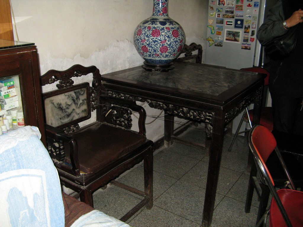 The dining area of the main room with long ago acquired furnishings