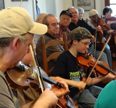 The youngest fiddler get's his solo chance.